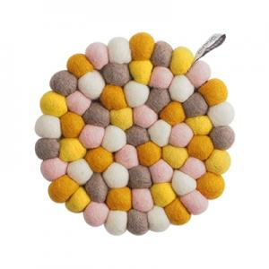 Round handmade trivet made of 100% wool - Mixed colors in yellow and pink.
