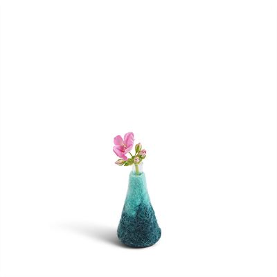 Small blue ombre vase made of wool with a glass for the flowers.