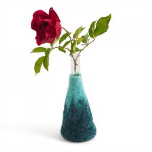 Large blue ombre vase made of wool with a glass for the flowers.