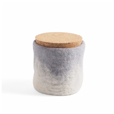 Handmade jar made of wool in concrete grey ombre with a lid of light cork.