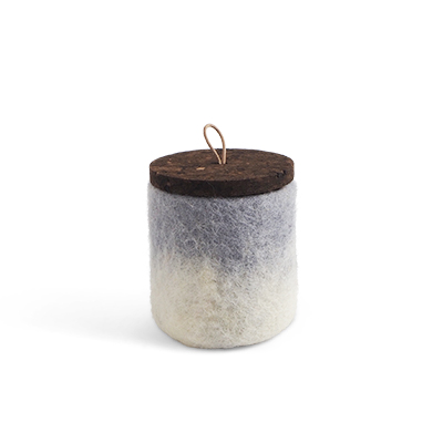 Handmade jar made of wool in concrete grey ombre with a lid of cork and leather.