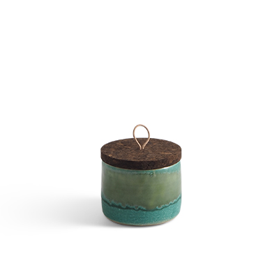 Handmade ceramic jar in teal ombre with a lid of cork and leather.