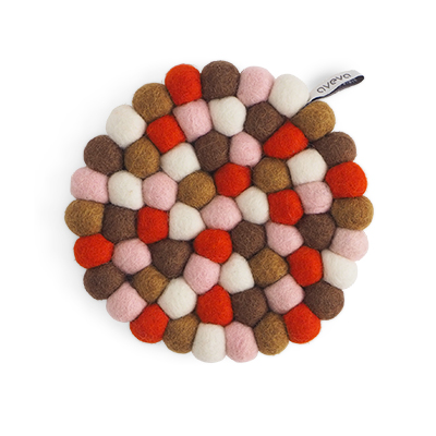 Round handmade trivet made of 100% wool - Mixed pink, rust and brown colors.