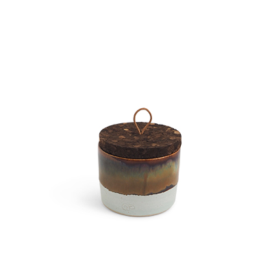 Handmade ceramic jar in black and brown ombre with a lid of cork and leather.