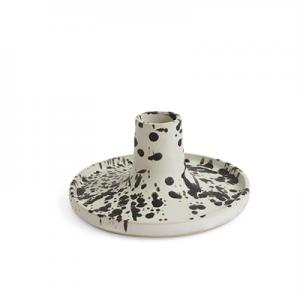 Handmade raw white ceramic candle holder with splashes of black color.
