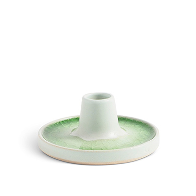 Handmade raw white ceramic candle holder with a glaze of recycled glass in green,