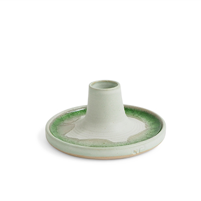 Handmade raw white ceramic candle holder with a glaze of recycled glass in green.
