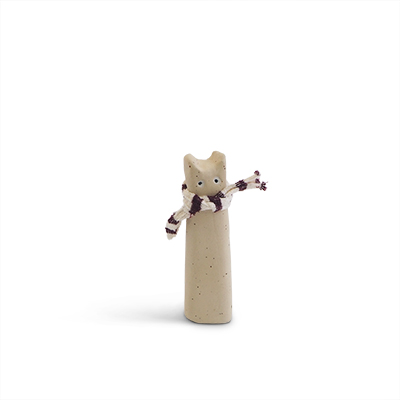 Cat made of raw stoneware. White cat with a scarf around the neck.