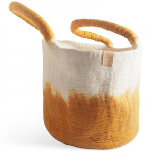 Large wool basket in white and mustard with ombre effect.