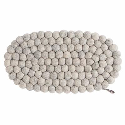 Oval trivet in 100% wool in raw gray.