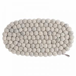 Oval trivet in 100% wool in raw gray.