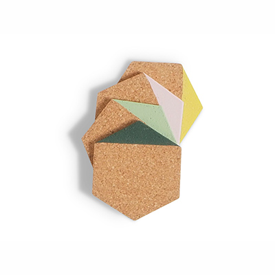 Coasters in hexagon made of light cork dipped in the color green, pistache, yellow and pink.
