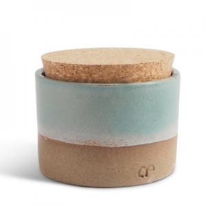 Handmade ceramic jar in teal glaze with a lid of light cork.