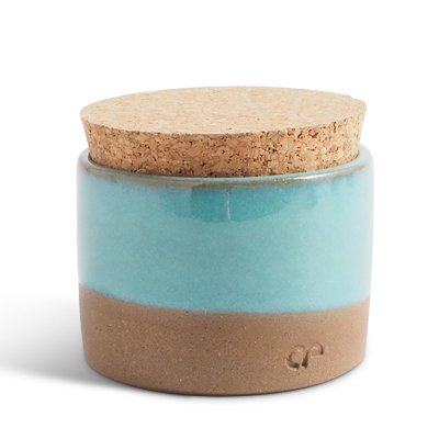 Handmade ceramic jar in turquoise glaze with a lid of light cork.
