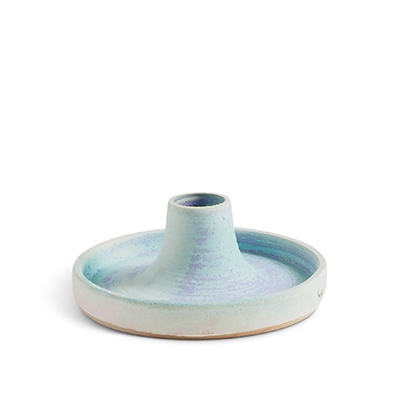 Handmade ceramic candle holder with a glaze in light blue.