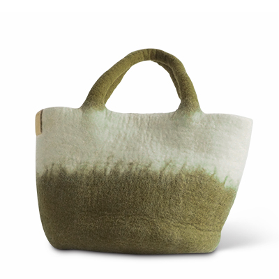 Smalll wool basket in white and olive green with ombre effect.