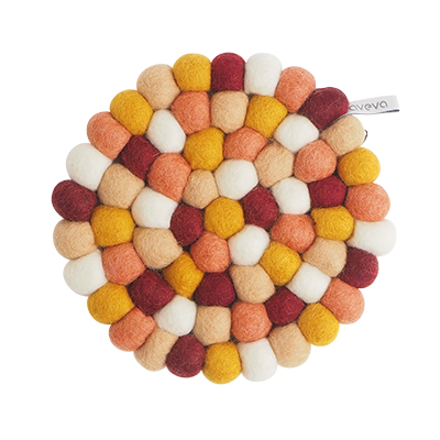 Round handmade trivet made of 100% wool - Mixed red, mustard yellow and apricot colors.