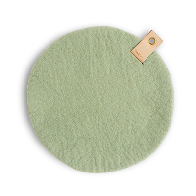 Round seat cushion in sage green wool with a hanger in eco leather.