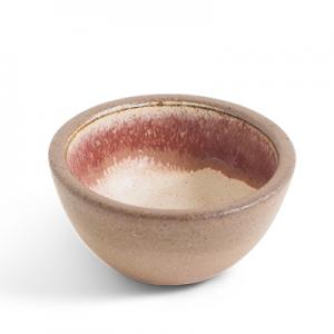 Small ceramic bowl with raw ceramics on the outside and pink, white and rustred glazing inside.