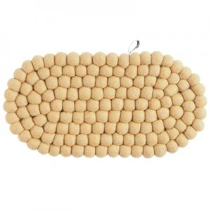 Oval trivet in 100% wool in sand color.