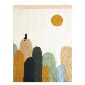 Poster in wool with a motive of a cat on hills. Colors in sand, sage green, moss green and ochre.