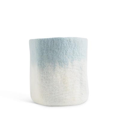 Large flower pot in light blue and white, made of wool with ombre effect.