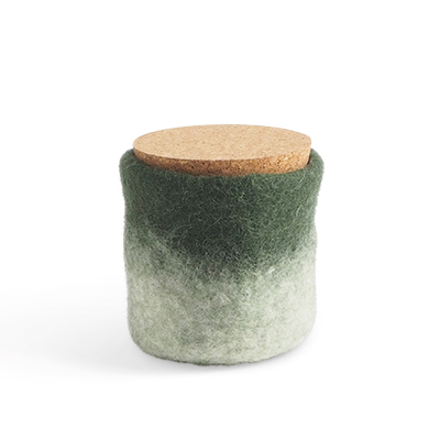 Handmade jar made of wool in moss green and white ombre with a lid of light cork.