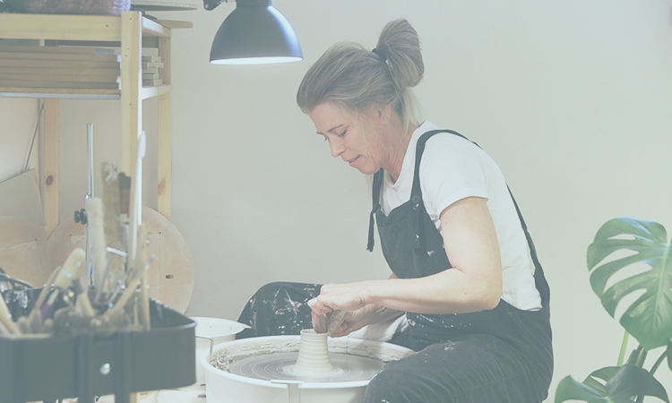 Aveva Design's founder and designer, making a pot out of clay.