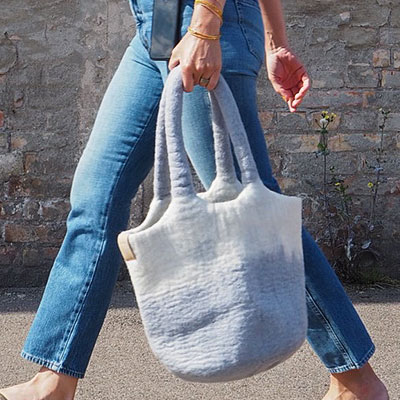 Bag/basket made of wool, in light grey and white.