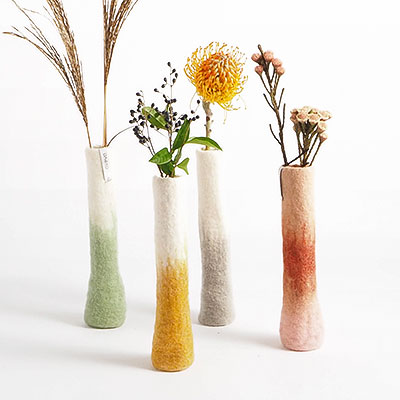 Long tall vases in 100% wool with flowers.