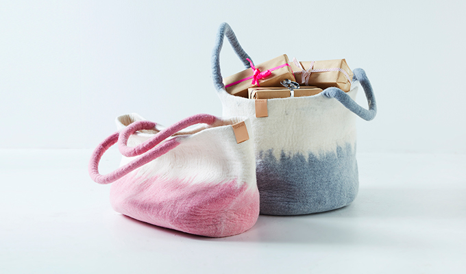 Basket - 100% wool - raw grey and pink, filled with gifts.