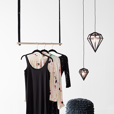 Detached clothes rack in wood with wool brackets. Diamond shaped lamps.