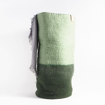 Tall laundry bag in 2 colors, with the bottom in moss green and the top in sage green.