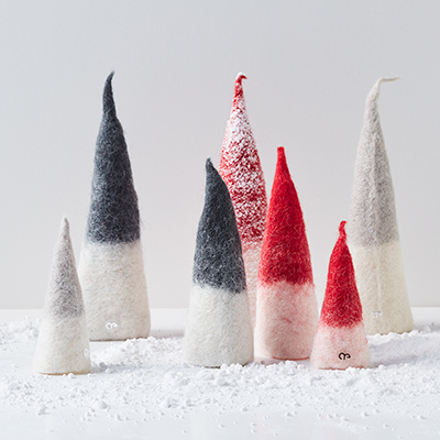 Pixies in a group made of wool, with fallen snow.