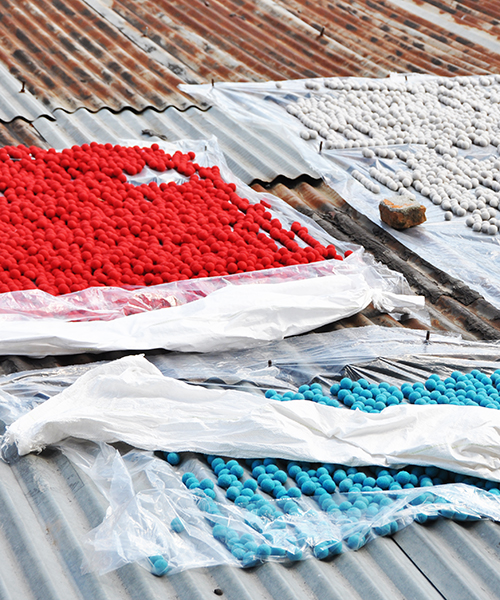 Wool balls in cheerful colors dried on a roof in Nepal.