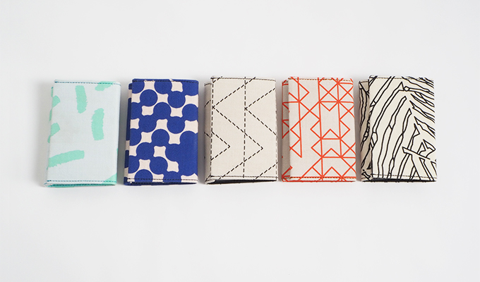 5 wallets in a row. Colorful colors.