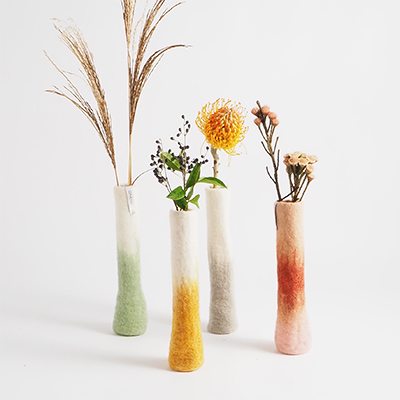 Standing tall wool vases in 100% wool in different colors.