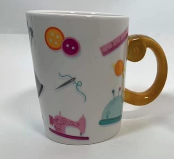 Kaffekopp med sy-artiklar