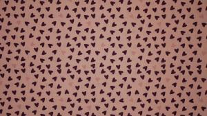 Hjärtan på rosa botten
