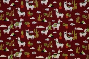 Lama med kaktusar på röd botten