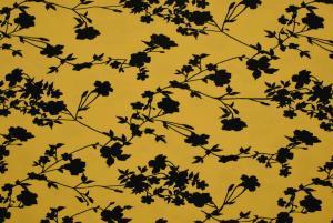 Svarta blommor på gul botten