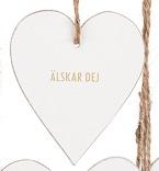 """Tags i trä, hjärta med guldtext: """"Älskar dej"""""""