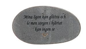 Grå sten med graverad text, Mina ögon kan glittra och le...
