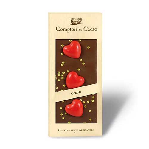 Ljus choklad (36%) med röda hjärtan och silverkulor