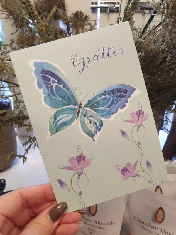 Grattis - Kort med turkose fjäril och lila blommor, Pictura