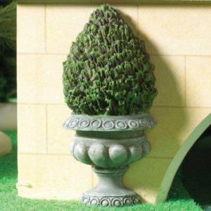 Grön figurklippt växt medium