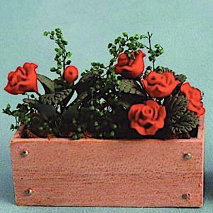 Blomlåda röda rosor balkonglåda