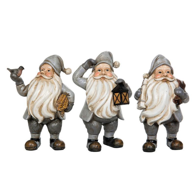 Jultomte- trio med olika utseenden