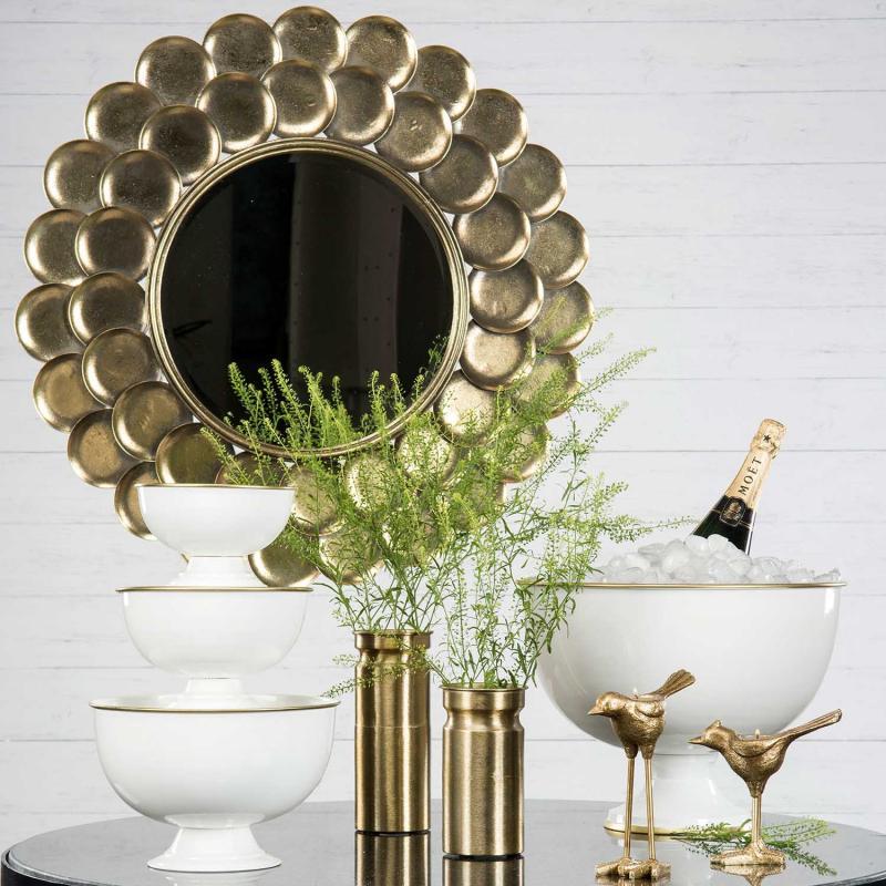 Spegel med guldfjäll