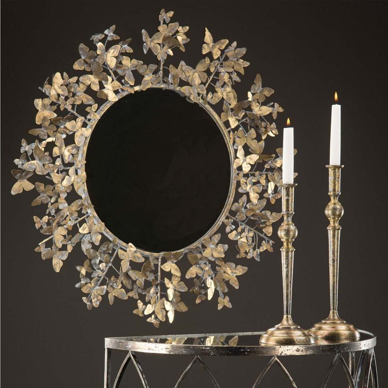 Spegel med fjärilsmönster